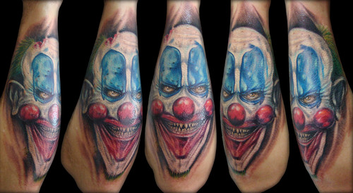 Evil Joker Face Tattoo On Arm