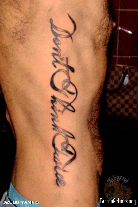 Fantastic Lettering Tattoo On Ribs For Men