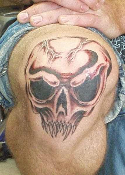 Fine Skull Tattoo On Knee