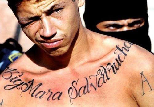 Gang Lettering Tattoo On Chest
