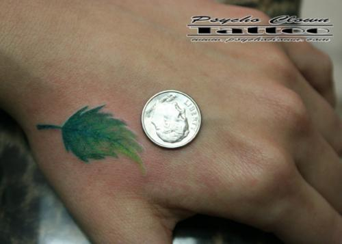 Green Leaf Tattoo And A Coin