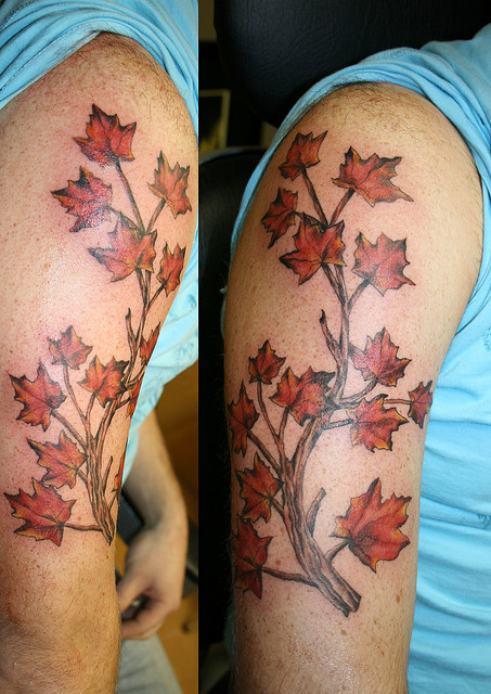 Half Sleeve Maple Leaves Tattoo On Arm