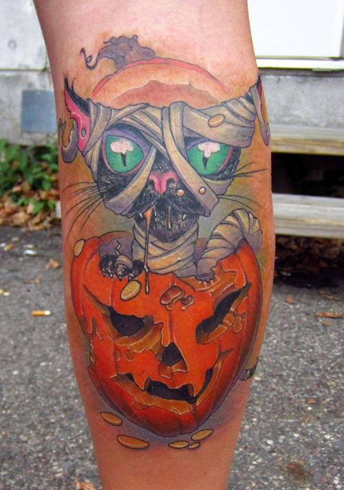 Halloween Black Cat In A Pumpkin Color Leg Tattoo Design
