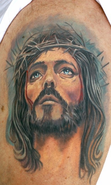 Jesus Face Portrait Tattoo On Biceps
