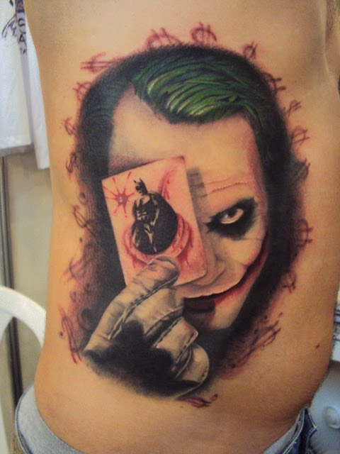 Joker Eye Card Tattoo On Rib Side