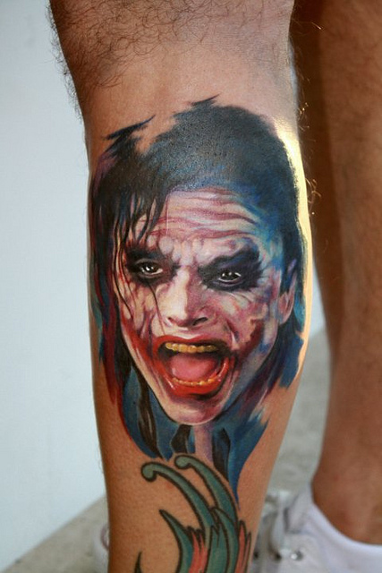 Joker Face Tattoo On Left Leg