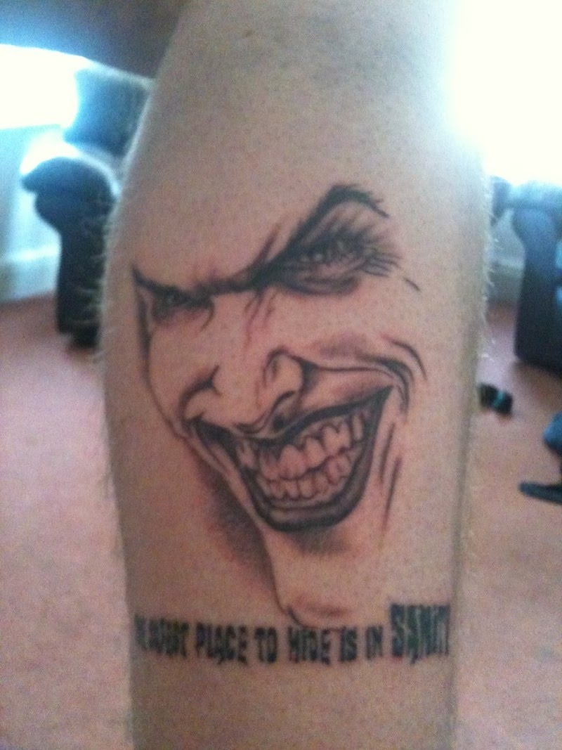 Joker Face Tattoo On Leg