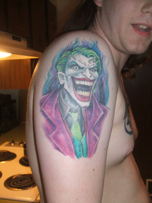 Joker Tattoo On Upper Arm For Guys