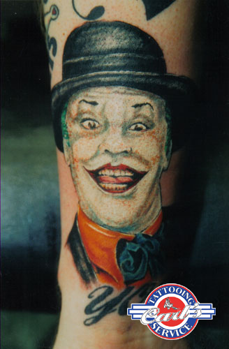 Joker Wearing Hat Tattoo On Forearm