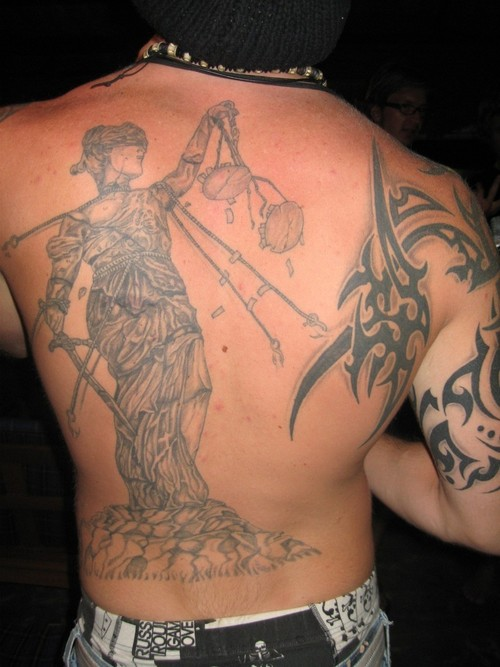 Justice Lady n Tribal Tattoo On Back Body