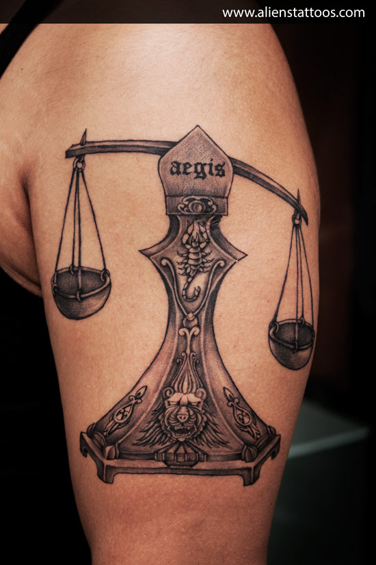Justice Scales Tattoo On Biceps
