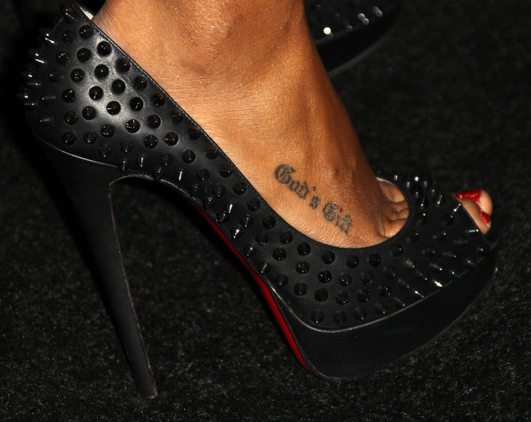 Kelly Rowland Lettering Tattoo On Foot