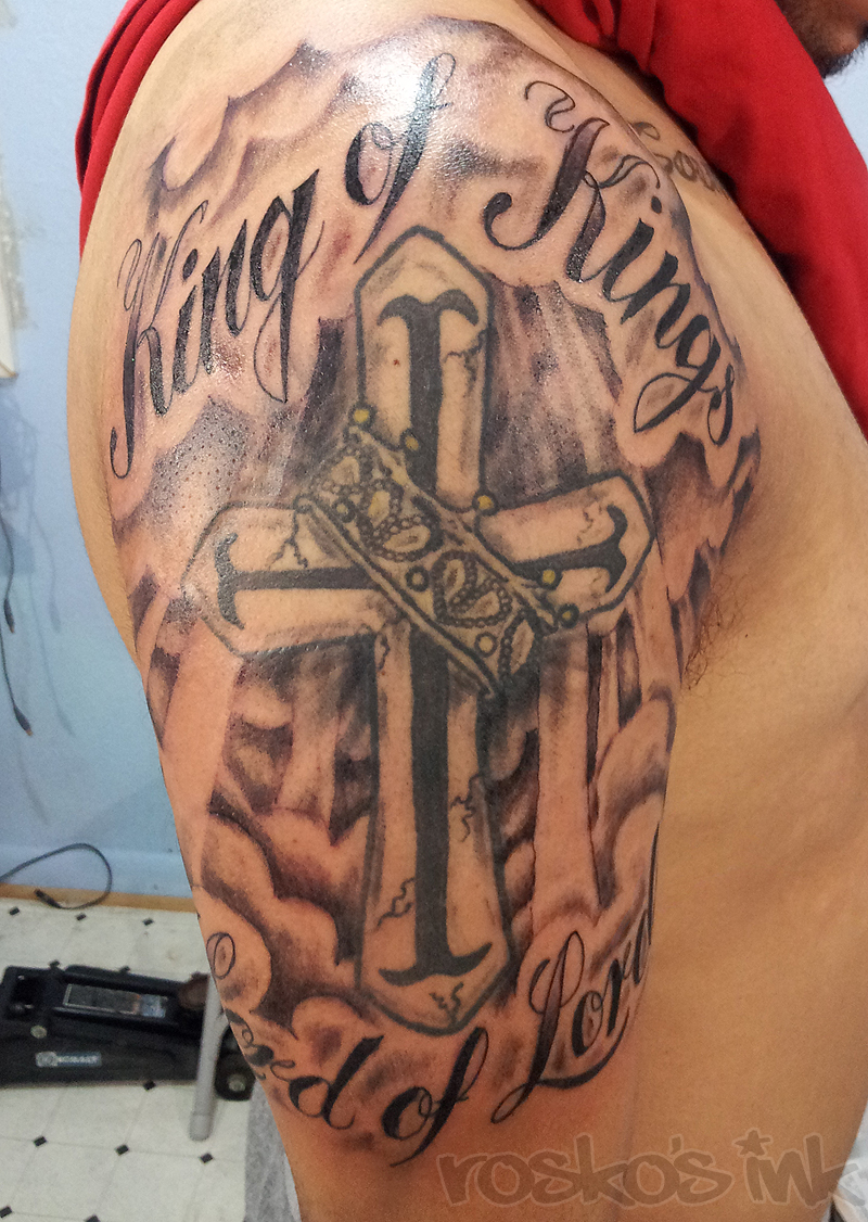 King Of King Tattoo On Upper Arm