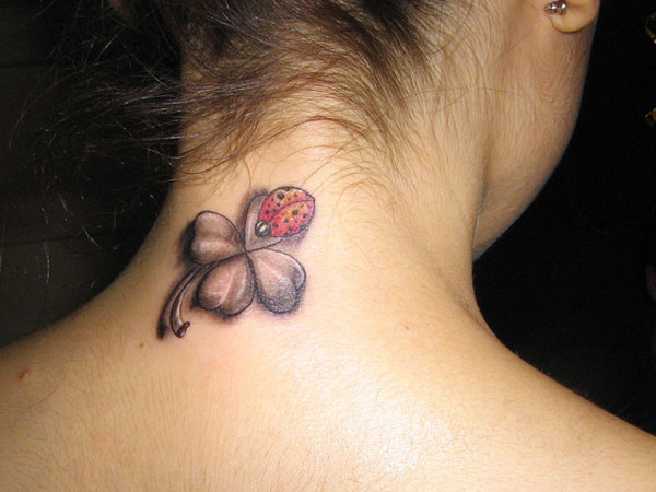 Lady Bug On Four Leaf Clover Tattoo On Back Neck