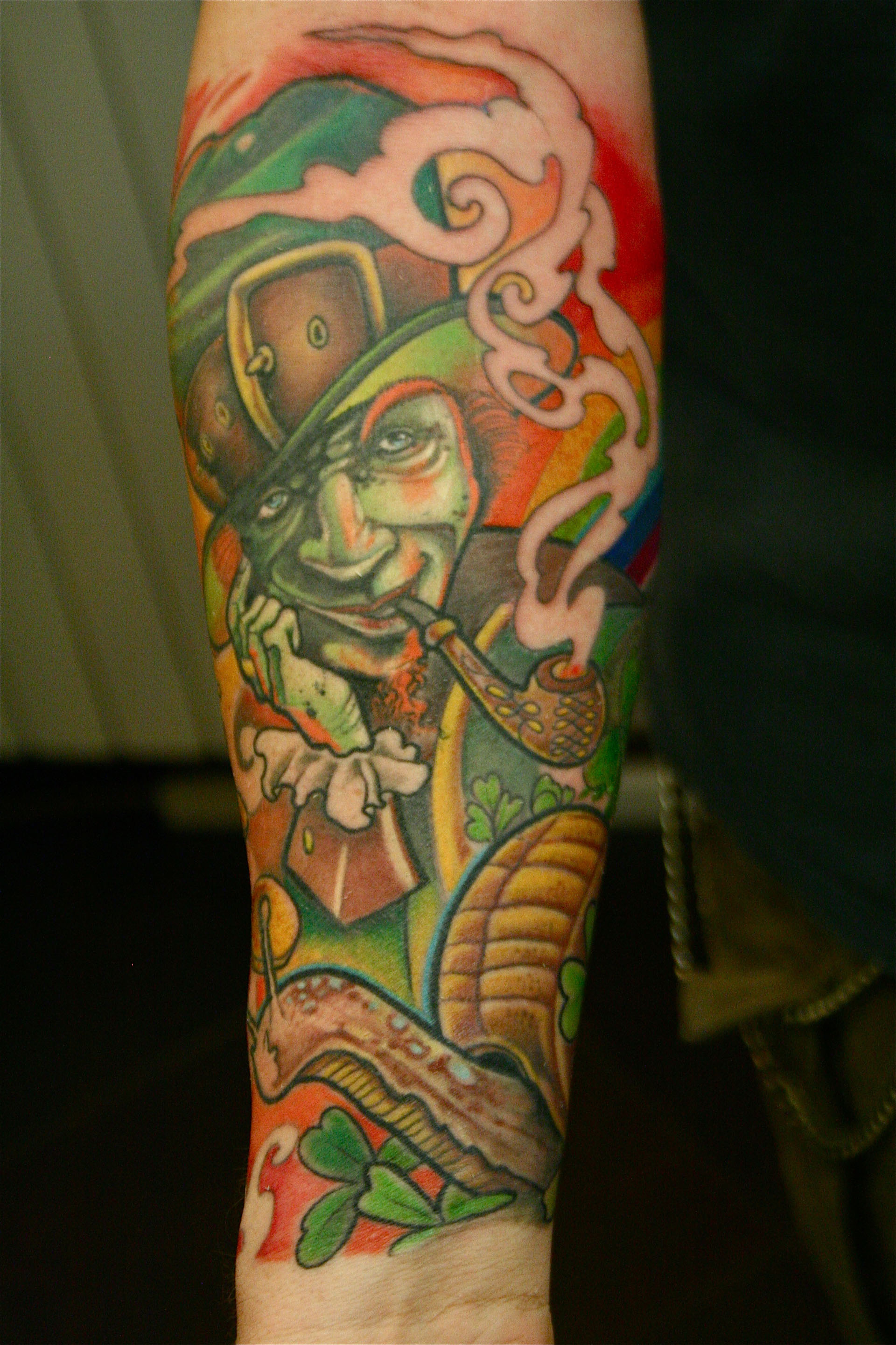 Leprechaun Smoking Pipe Tattoo On Lower Arm