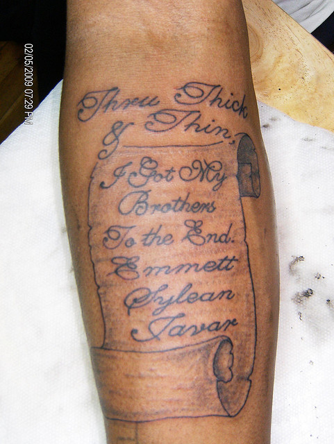 Lettering Scroll Tattoo On Forearm