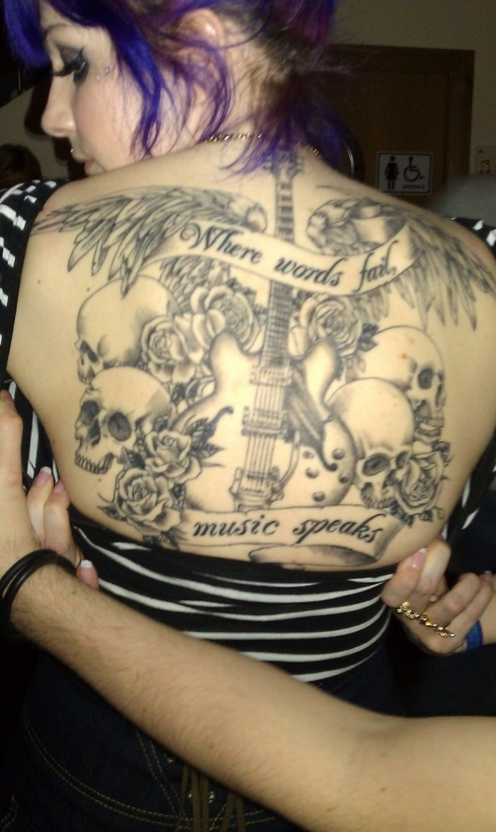 Lettering Tattoo On Back For Music Lovers