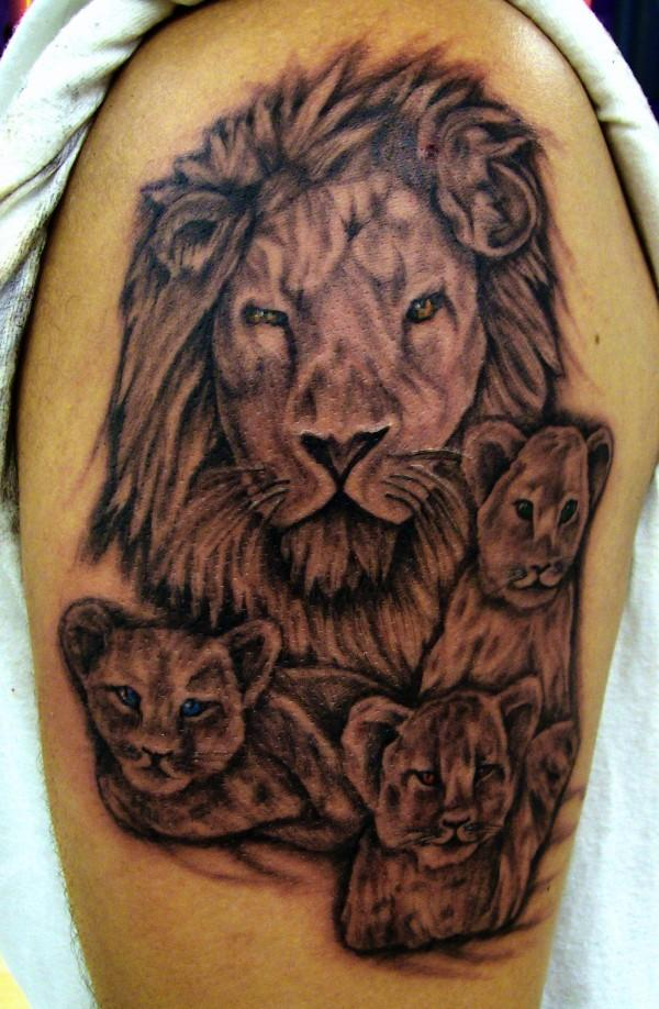 Lion And Cubs Tattoo On Biceps