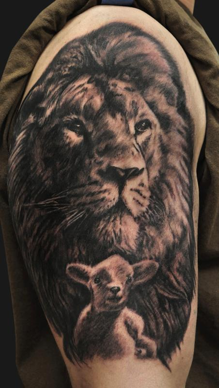 Lion And Lamb Tattoo On Upper Arm