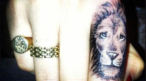 Lion Face Tattoo On Finger