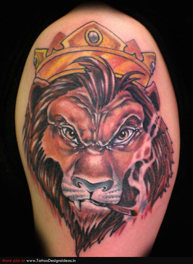 Lion Head With Crown Tattoo On Biceps
