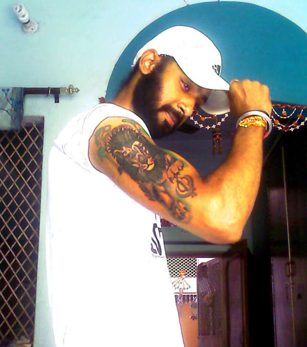 Lion In Jungle Tattoo On Biceps