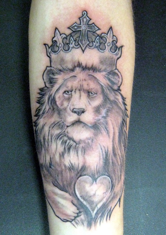 Lion King With A Broken Heart Tattoo On Arm