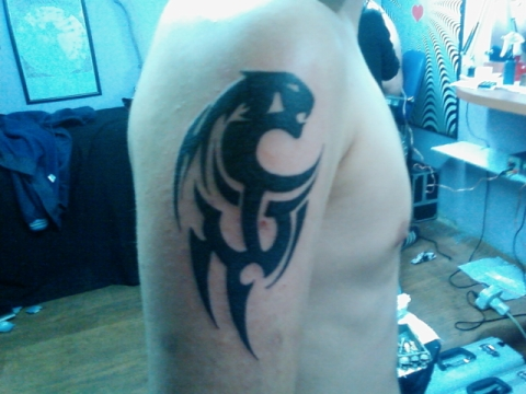 Lion Tribal Tattoo On Upper Arm For Men