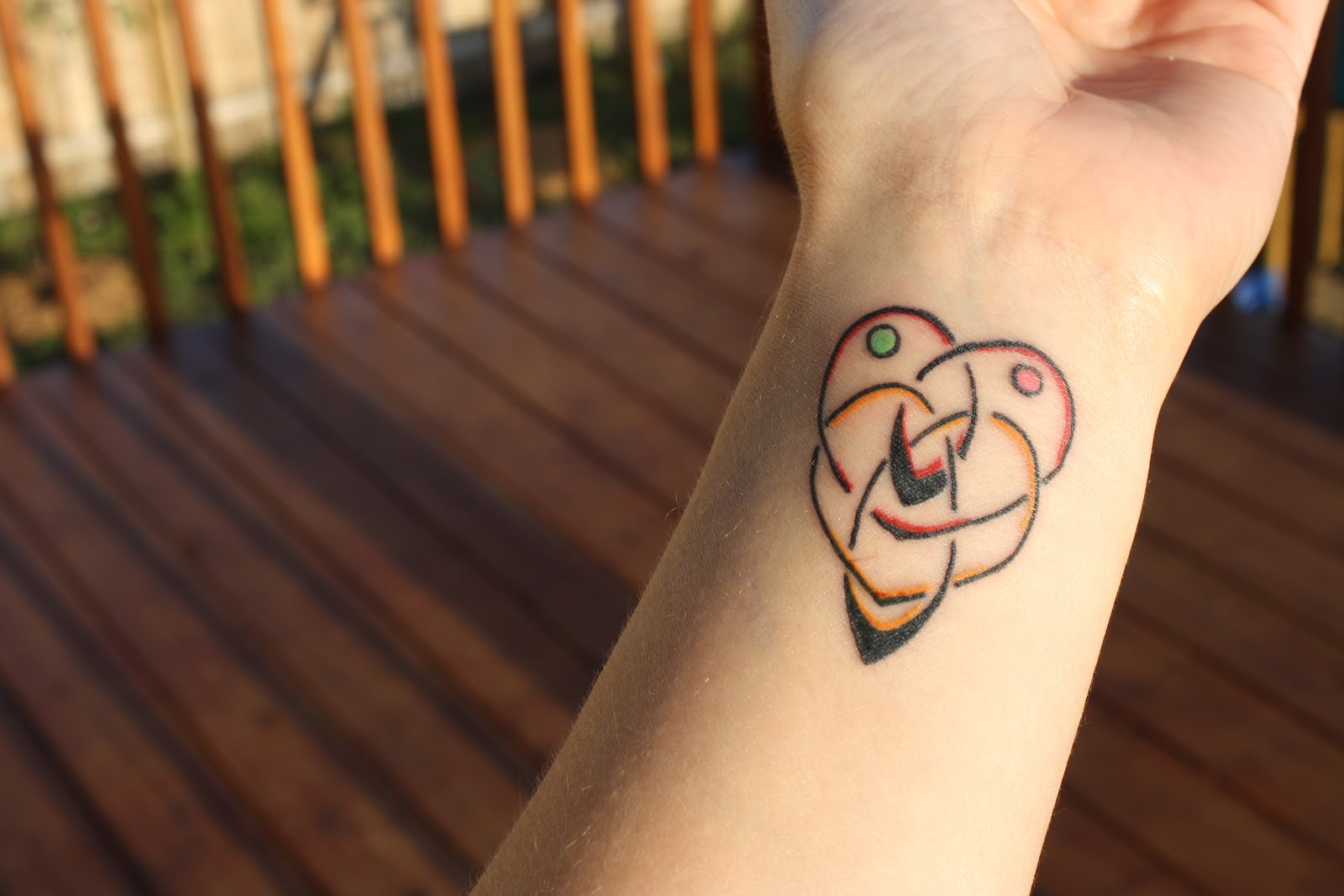Motherhood Knot Tattoo On Wrist