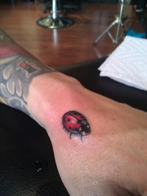 Moving Ladybug Tattoo On Wrist