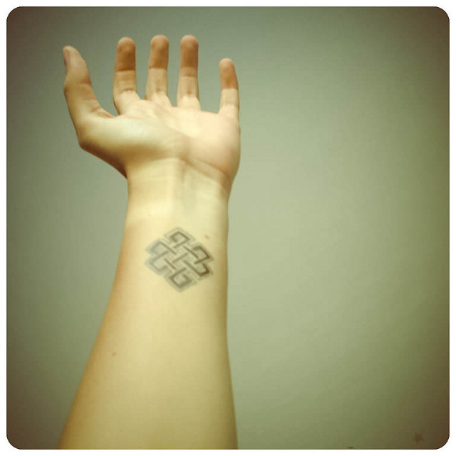 Nice Endless Knot Tattoo On Wrist