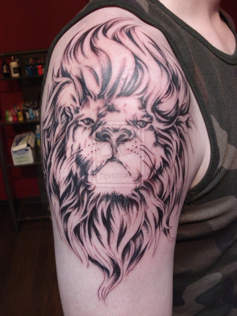 Nice Lion Tattoo On Biceps