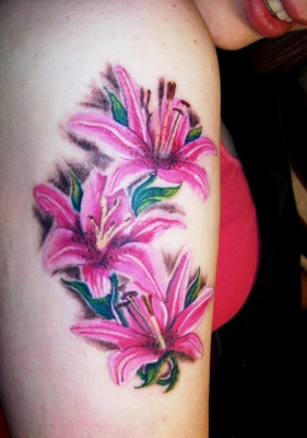 Pink Lily Flowers Tattoo On Arm For Girls