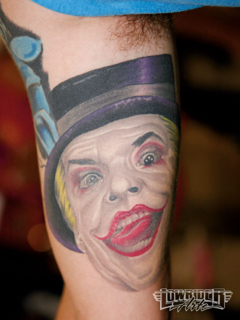 Realistic Joker Face Tattoo On Muscles