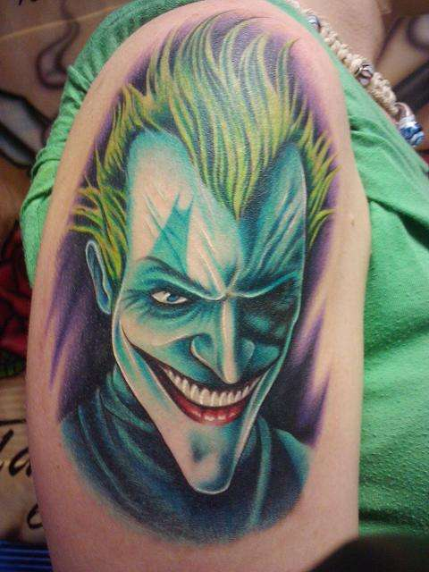 Realistic Joker Face Tattoo On Upper Arm