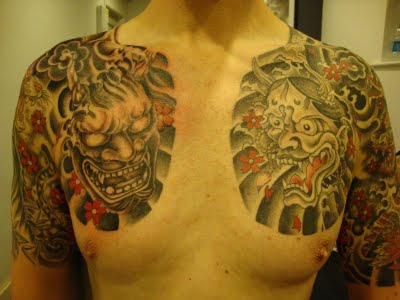 Asian Mask Tattoos On Chest For Men
