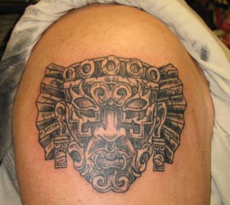 Aztec Mask Tattoo On Shoulder For Men