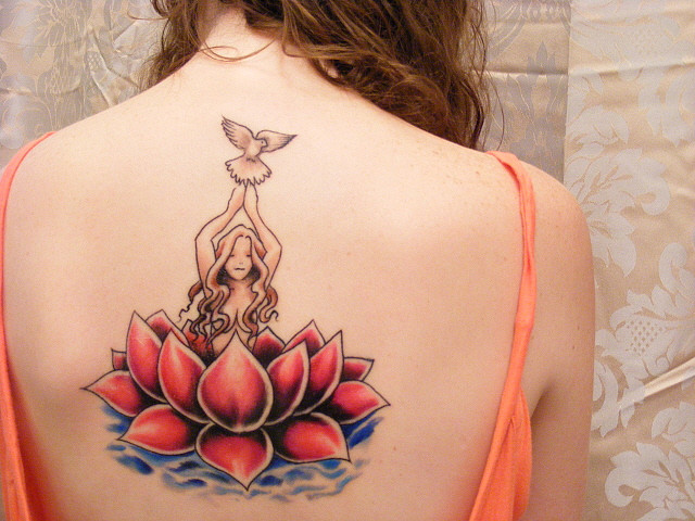 Beautiful Lotus Tattoo On Upper Back For Women