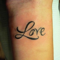 Black Ink Love Tattoo On Wrist