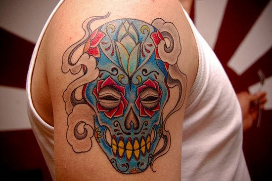 Blue Ink Mexican Sugar Skull Tattoo On Shoulder