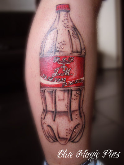 Coca Cola Memorial Tattoo On Leg