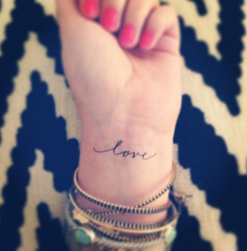 Cute Love Word Tattoo On Wrist