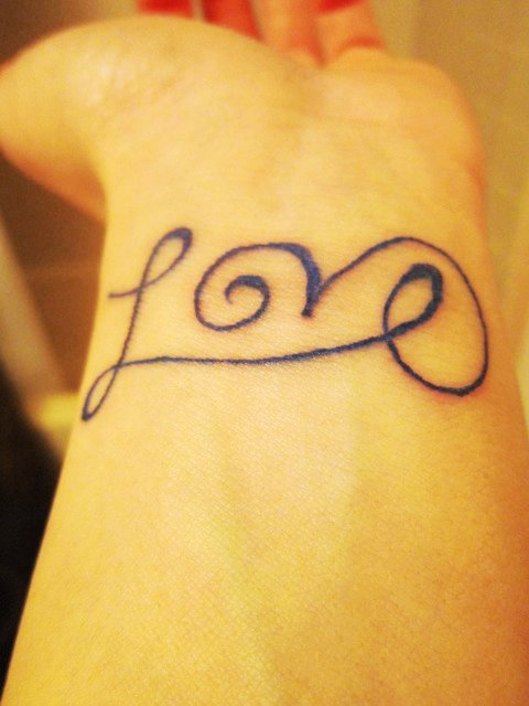 Cute Short Love Tattoo On Wrist