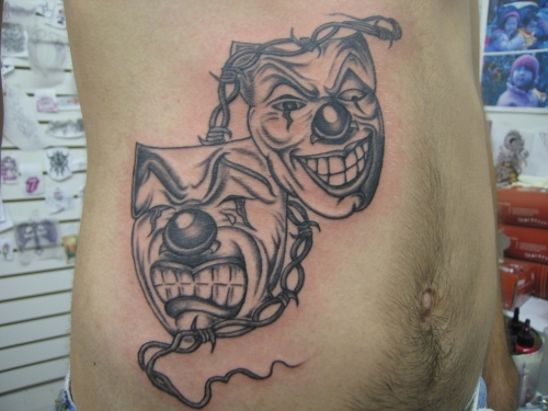 Drama Mask Tattoo On Ribs For Men