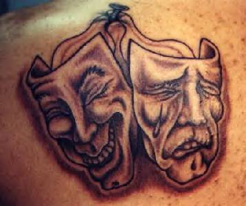 Drama Mask Tattoos On Back