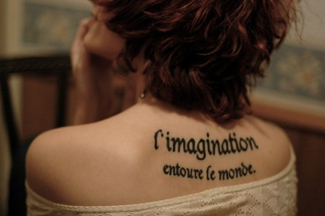 French Literary Tattoo On Upper Back For Girls