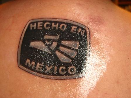 Glowing Mexican Tattoo On Back