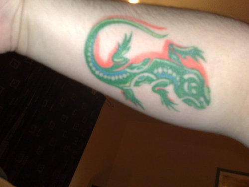 Green Ink Lizard Tattoo On Arm