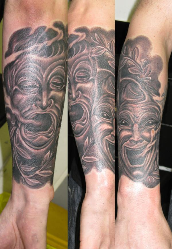 Grey Ink Drama Mask Tattoo On Arm
