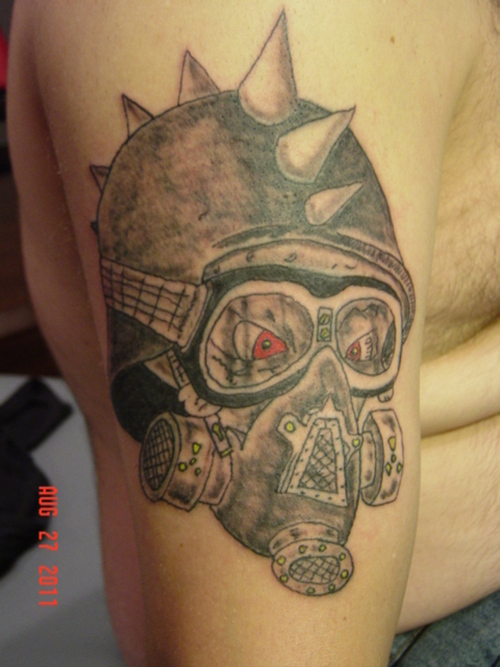 Grey Ink Gas Mask Tattoo On Biceps